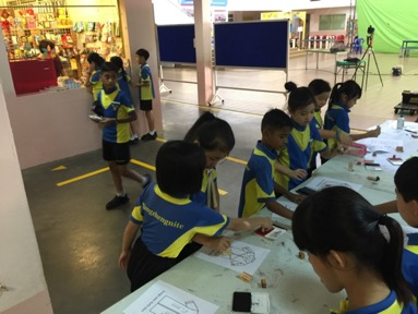 "Pupils trying out ""batik-making"" at one of the art and craft booths.jpg"