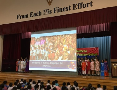Pupil representatives from various nationalities leading the school in the singing of the ASEAN theme song..jpg